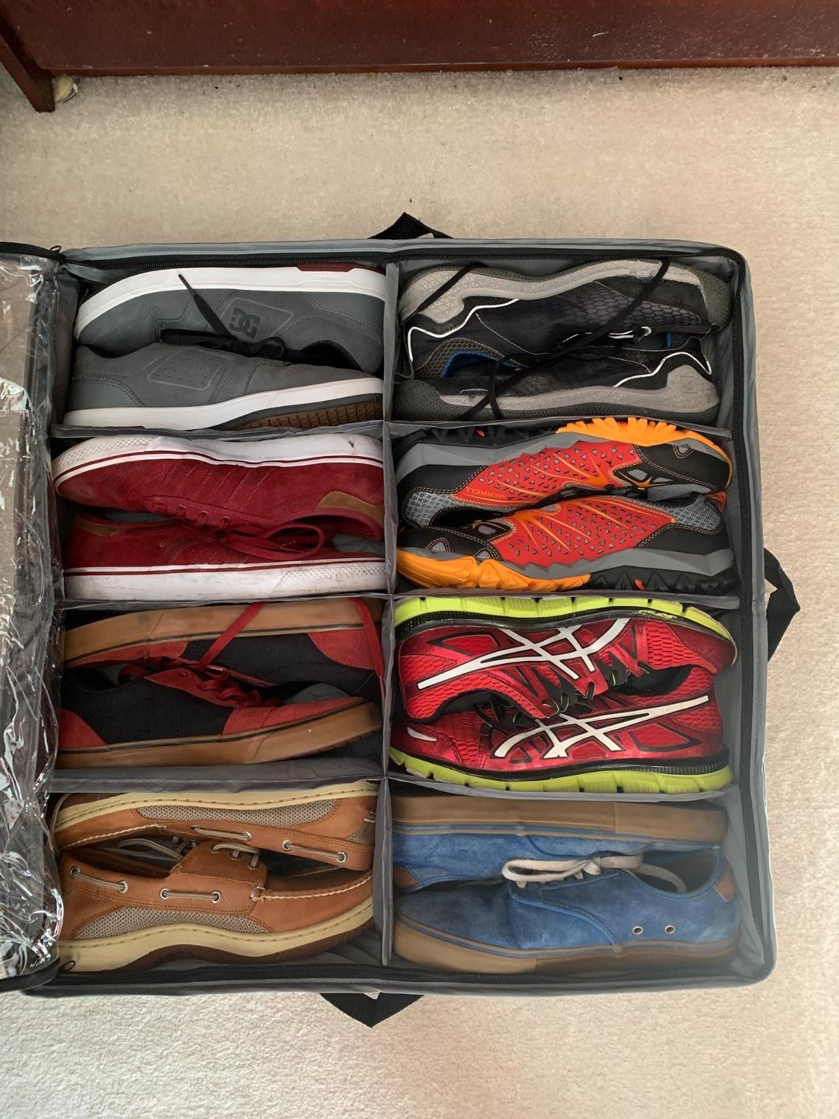 A shoe bag holding eight pairs of shoes
