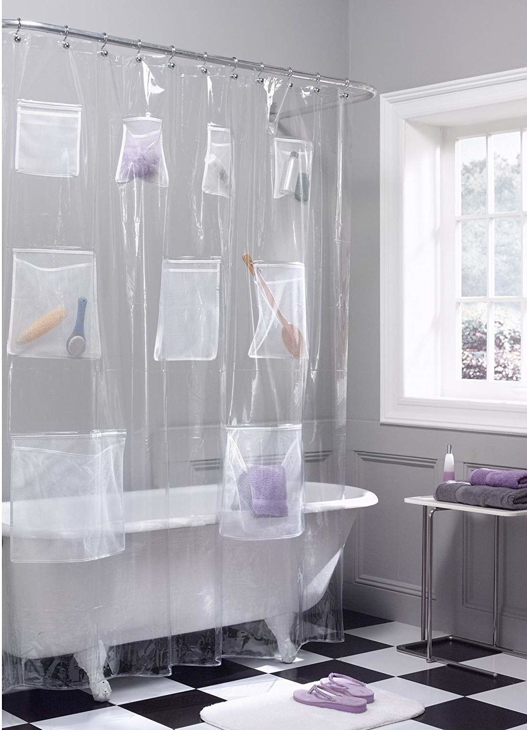 The clear plastic curtain, with two big pockets at the bottom, three medium ones in the middle, and four smaller ones near the top