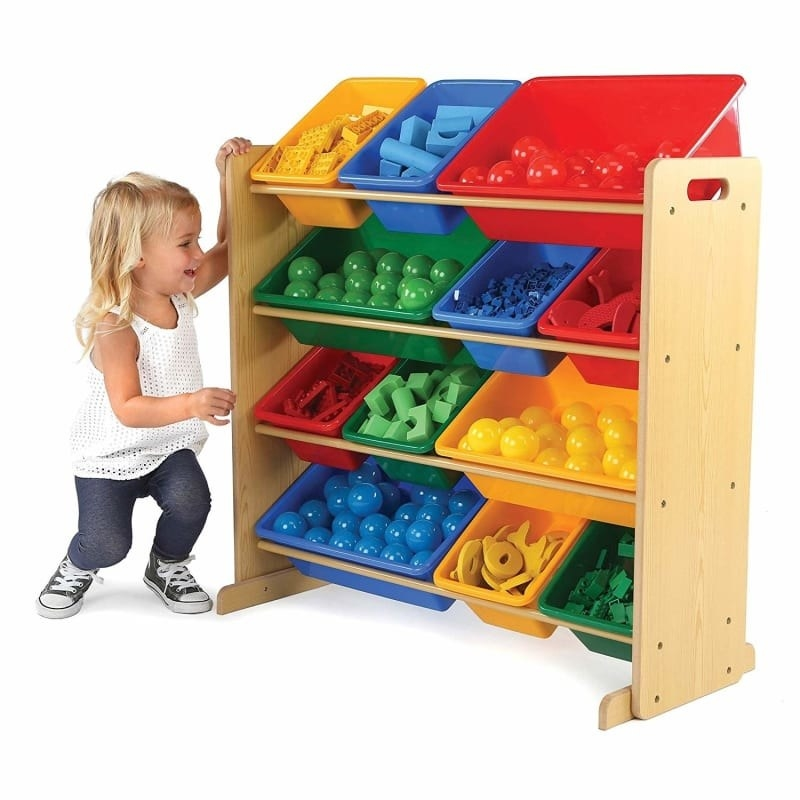 A child model with the shelf that's about as tall as she is; but instead of being traditional shelves, it holds 12 bins of toys in four rows