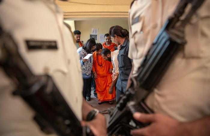 Sadhvi Pragya Singh Thakur prepares to address the media before heading out for campaigning.