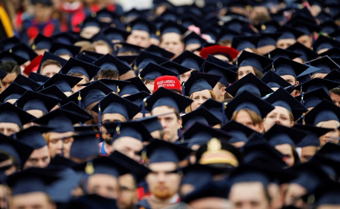 """A graduate wears a """"Make America Great Again"""" hat amid a sea of mortarboards before the start of commencement exercises at Liberty University in Lynchburg, Virginia, May 11."""