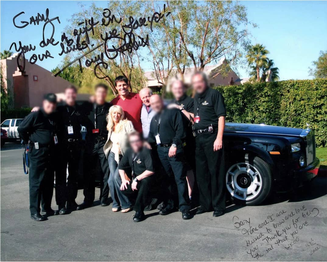 Gary King with Robbins, his current wife Sage, and their security team.