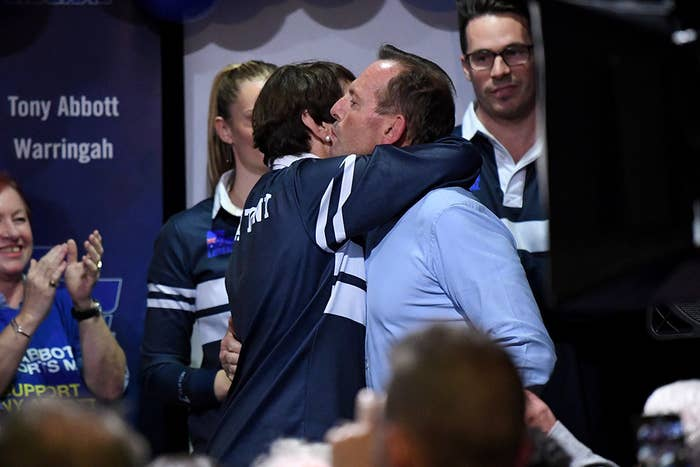 Tony Abbott embraces his wife Margie after giving his concession speech.