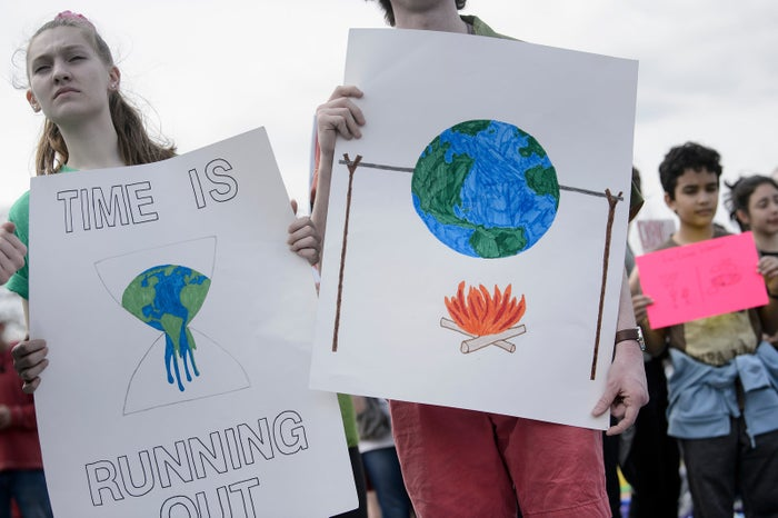 People rally for action on climate change outside the US Capitol.