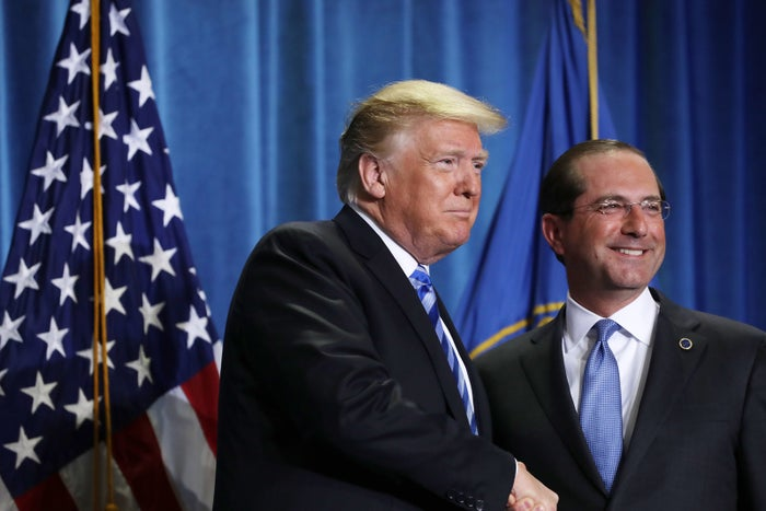 President Donald Trump shakes hands with Health and Human Services Secretary Alex Azar.