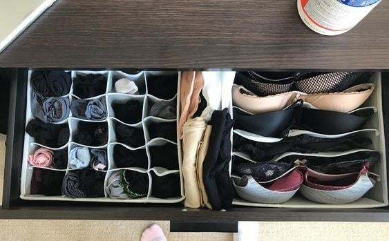 Reviewer's drawer with the divider set inside to organize their stockings, underwear, socks, and bras