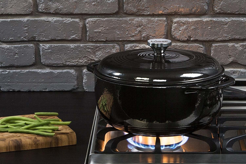 Black enamel dutch oven over open flame
