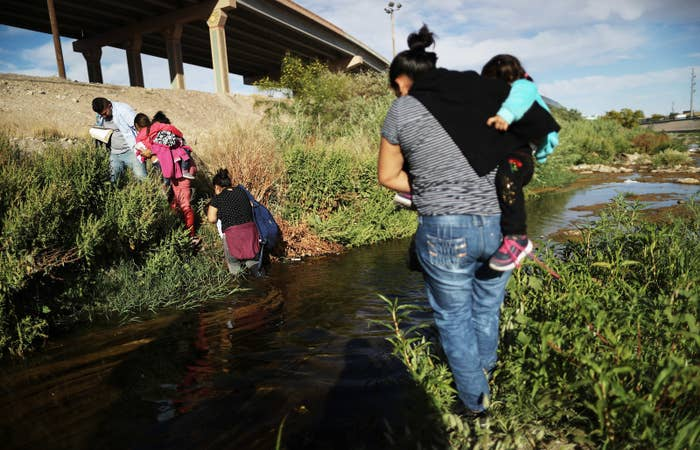 Migrants cross the US–Mexico border at the Rio Grande River on May 19.