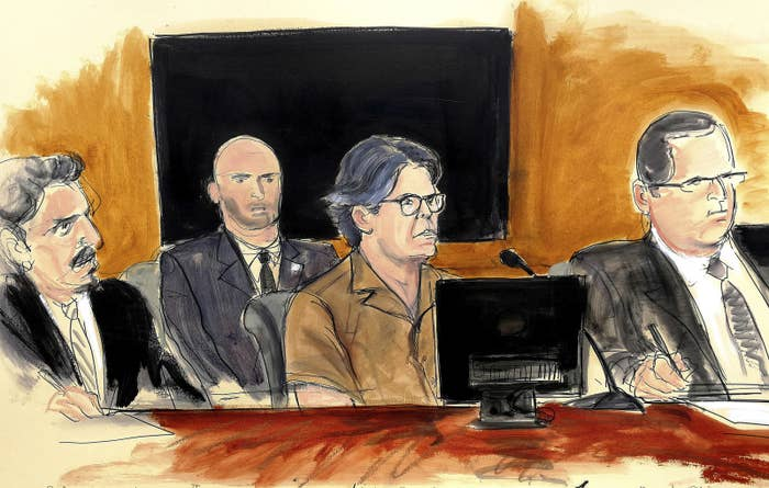In this April 13, 2018, courtroom sketch, Keith Raniere, center, attends a hearing.