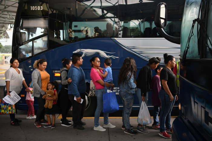 Migrant families recently released from detention board a bus at a depot in McAllen, Texas.
