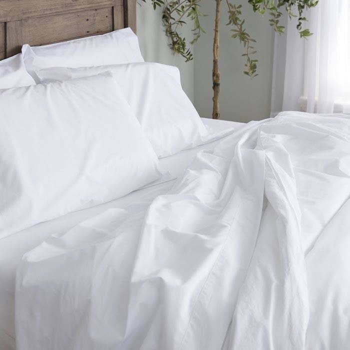 A Breathable Percale Sheet Set That Won T Trap Your Body Heat In While You Sleep Plus They Ll Only Get Softer With Every Wash