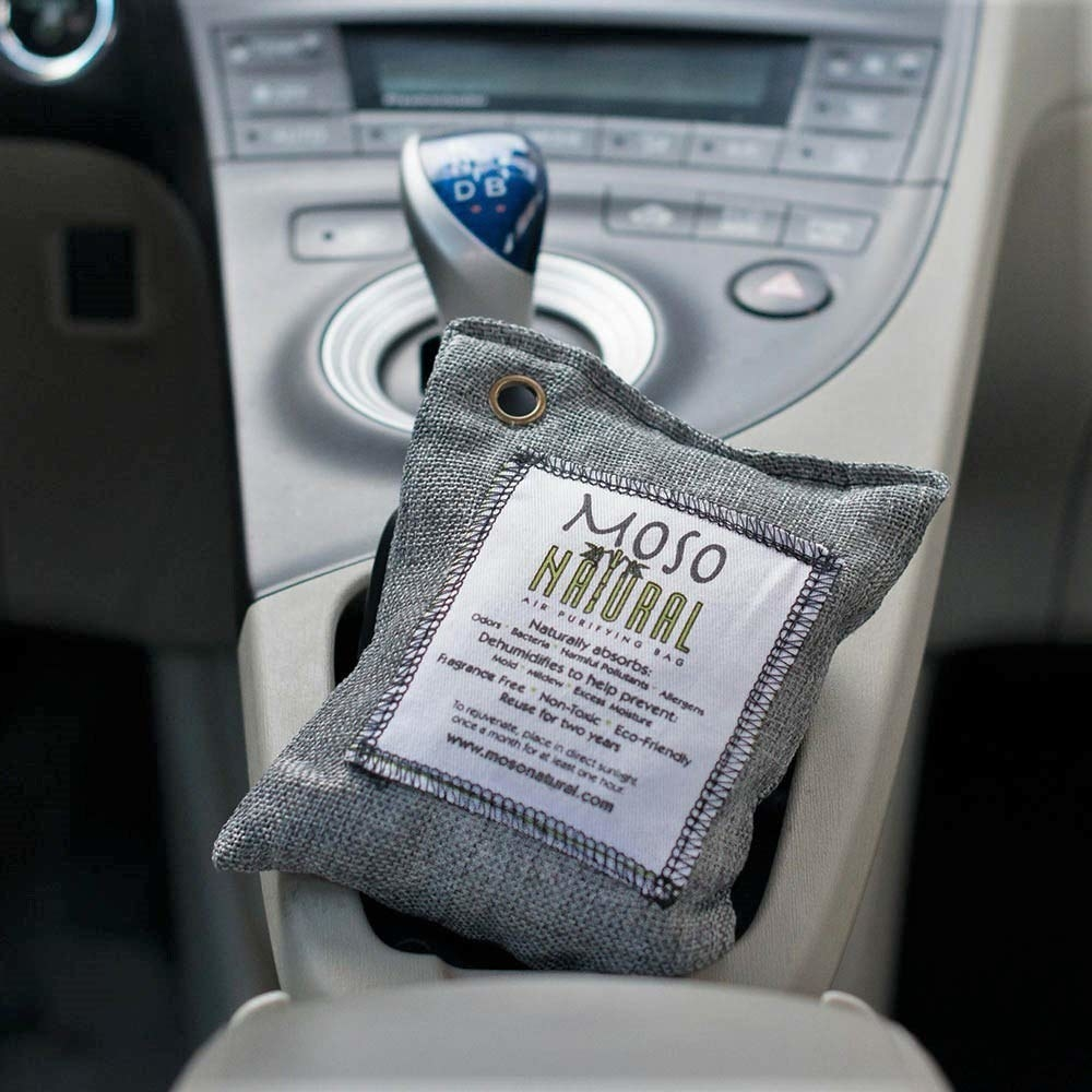 Moso Natural charcoal bag placed in the center console of a car