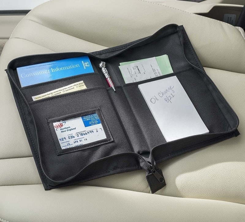 The case opened up on the seat showing different pockets to hold insurance cards