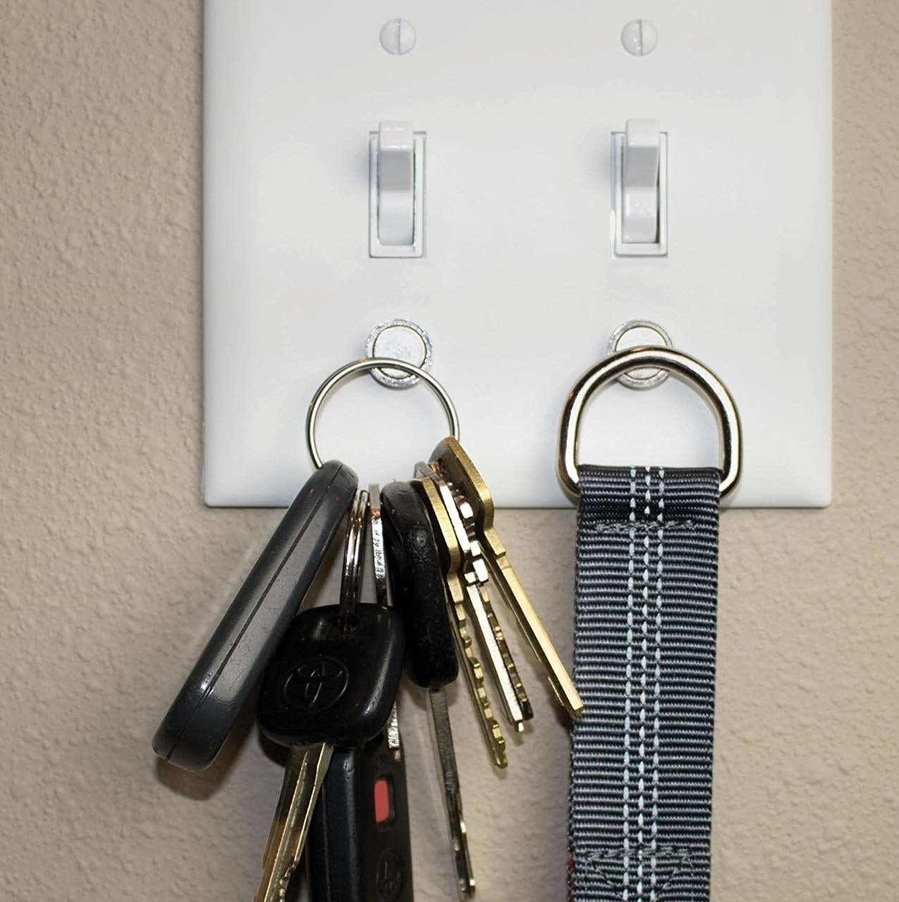 The keys magnetically sticking to the light switch