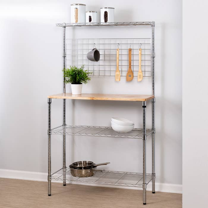 """Promising review: """"This is the perfect work station for my little kitchen. I don't have much counter space so this adds just the right amount needed and since I can store all my baking items on the racks, I have everything I need at hand. Best thing I've ordered in a long time."""" —MuffyTuffetGet it from Walmart for $89."""