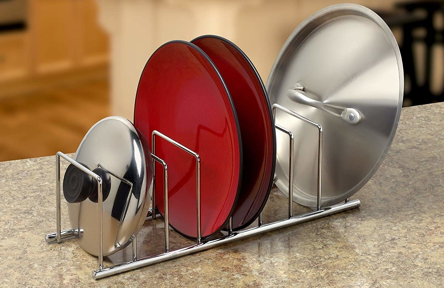 plates and pan lids in the rack