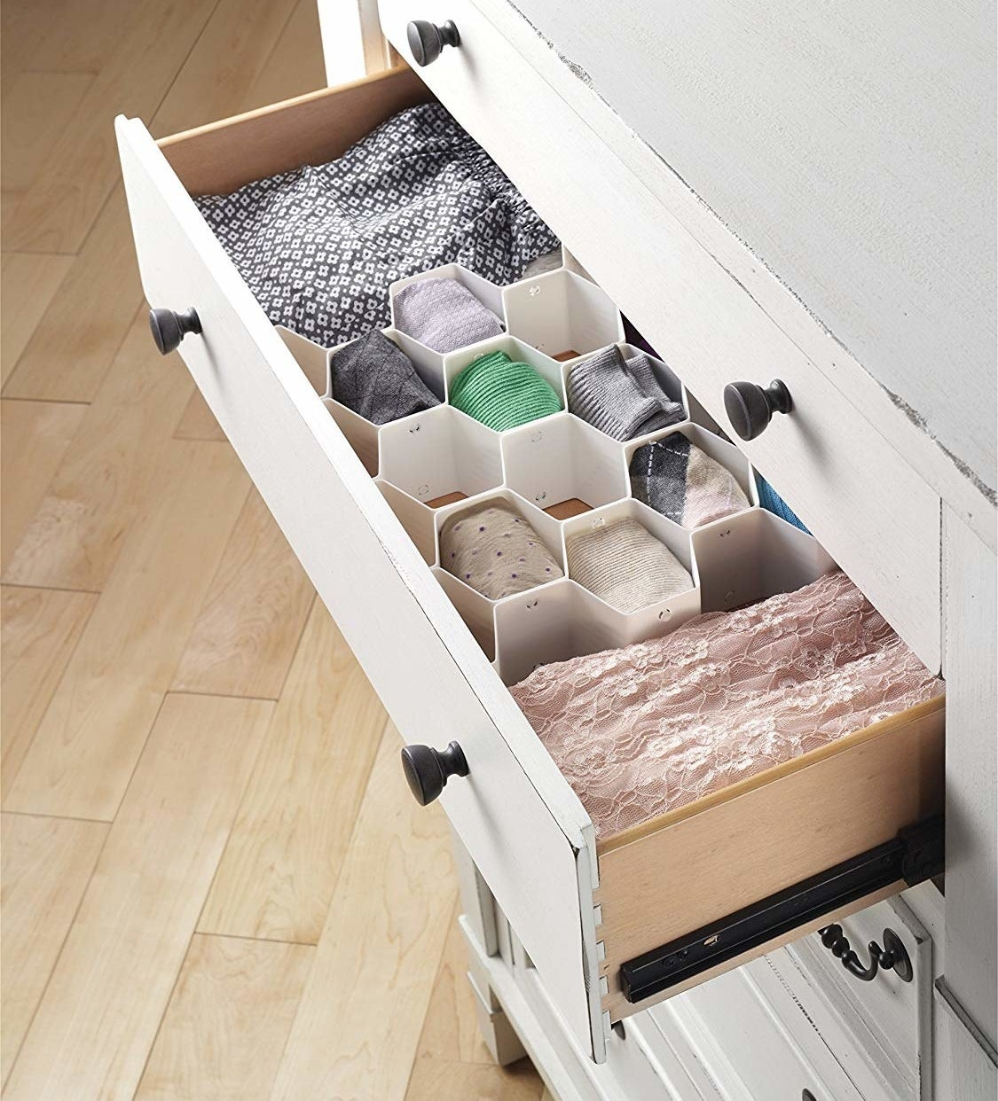 the honey comb organizer inside of a drawer
