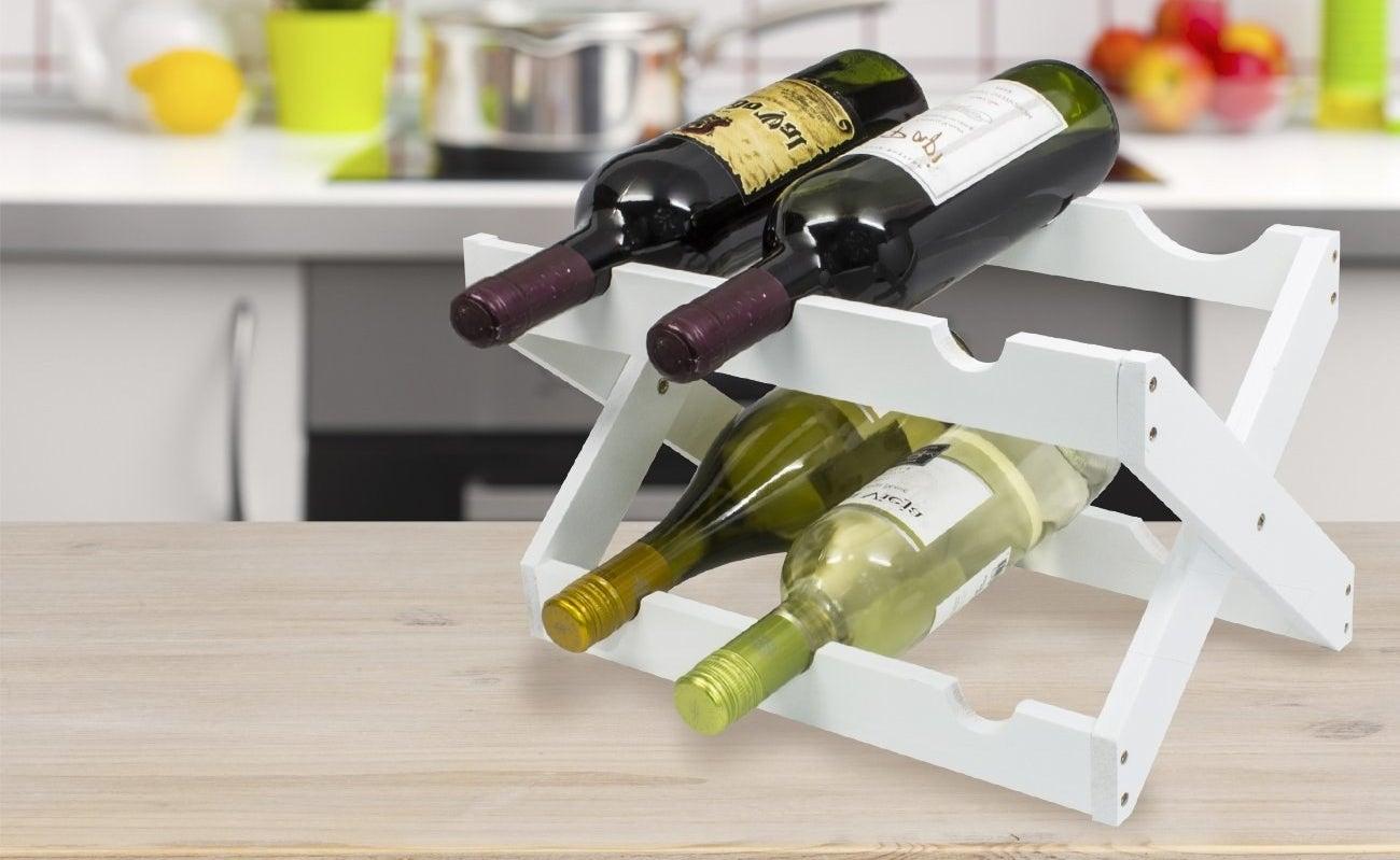 the rack in white holding bottles of wine