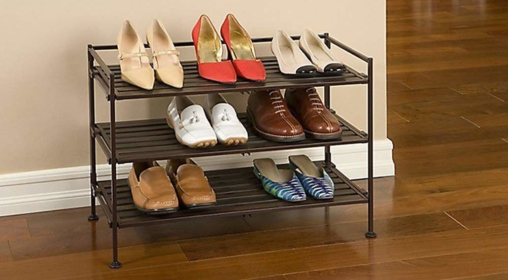 the three-tier rack holding various pairs of shoes