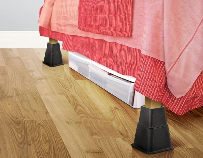 the bed risers creating additional under bed storage space for clothing storage