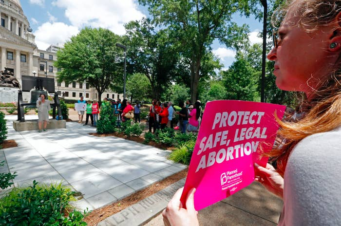 Demostrators protest anti-abortions laws in Jackson, Mississippi, May 21, 2019.