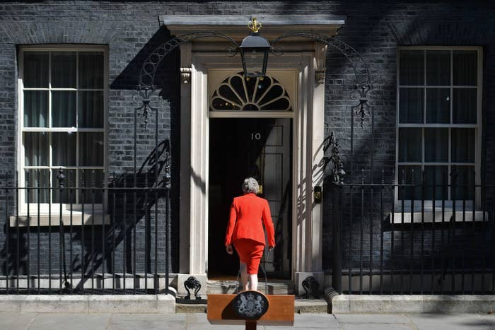 Prime Minister Theresa May leaves after she announces her resignation outside 10 Downing Street.