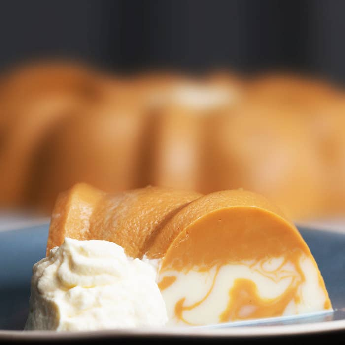 Servings: 10-12INGREDIENTS400 milliliters hot water20 grams gelatin390 grams condensed milk380 grams dulce de leche360 milliliters milk240 milliliters whipping cream100 grams powdered sugar PREPARATIONIn a bowl with warm water, add gelatin and mix well until all lumps are gone.Divide the gelatin mixture into two bowls. Add the condensed milk to a bowl with 240 milliliters of milk. To the second bowl, add the dulce de leche and 120 milliliters of milk. Whisk both well until smooth.Add the dulce de leche mixture to a ring mold, followed by the condensed milk. Refrigerate overnight.In a bowl, combine whipping cream and sugar until stiff peaks form. Place a plate on the open side of the mold and invert the gelatin. Serve with whipped cream, and enjoy! Inspired by El Mejor Nido: https://www.elmejornido.com/es/recetas/gelatina-de-dulce-de-leche-138915Also inspired by Recetas de Cocina Fácileshttp://recetasdecocinafaciles.net/gelatina-de-nutella-y-queso-crema/