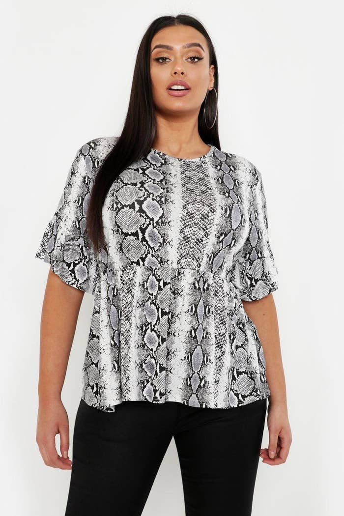 """6a7e2269c63 34. A ruffle sleeve top that will be slithering into your shopping cart  faster than you can say """"AT WHAT POINT did snakeskin become so popular?"""