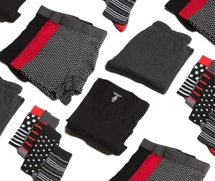 Various patterns and colors of men's clothing items such as shirts, boxers, sweatpants, and socks being displayed as options of clothing people can expect to receive from this service