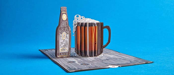 A 3D pop-up card, where the pop-up is a pitcher of beer and a bottle of beer