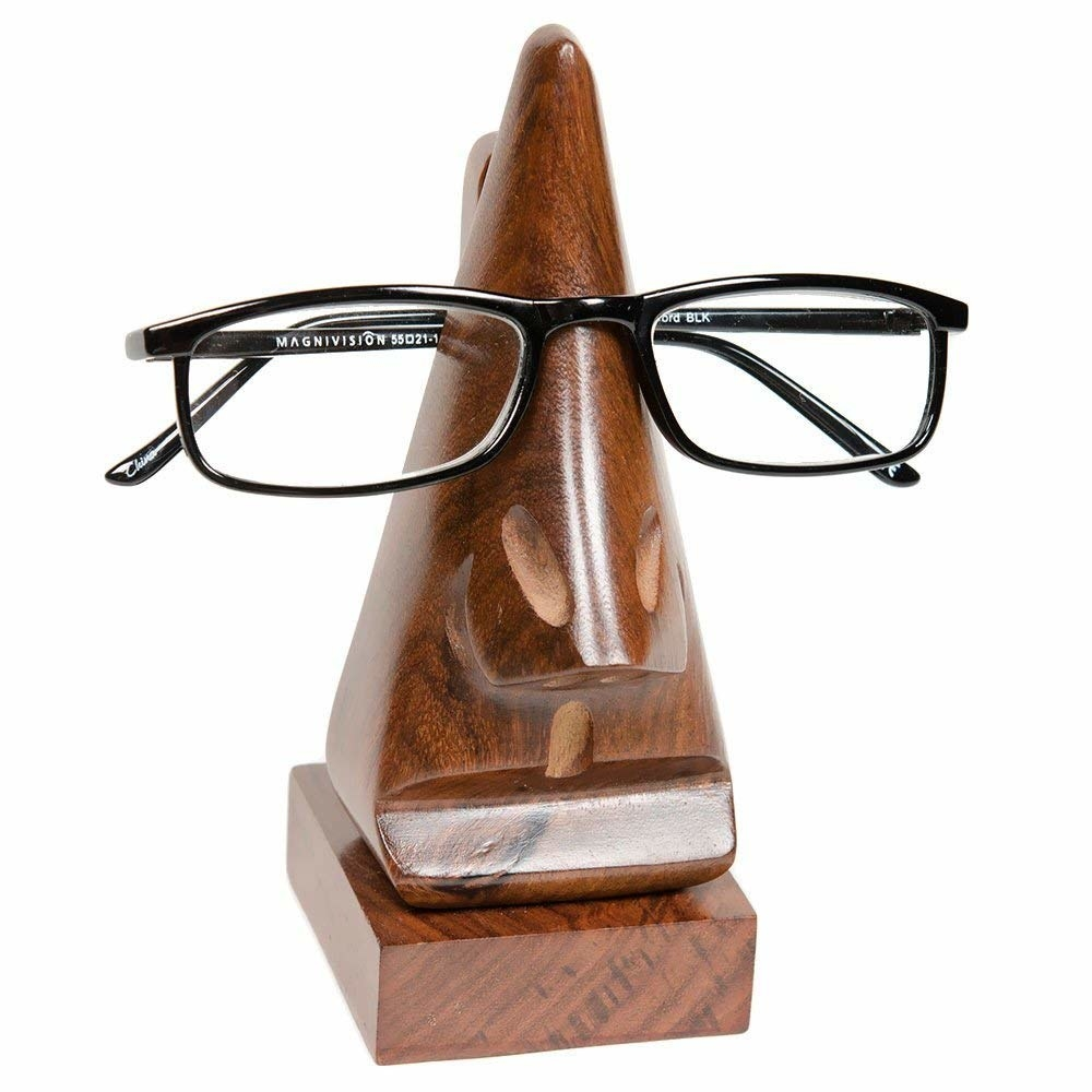 Closeup of wood eyeglass that looks like a face with glasses on it