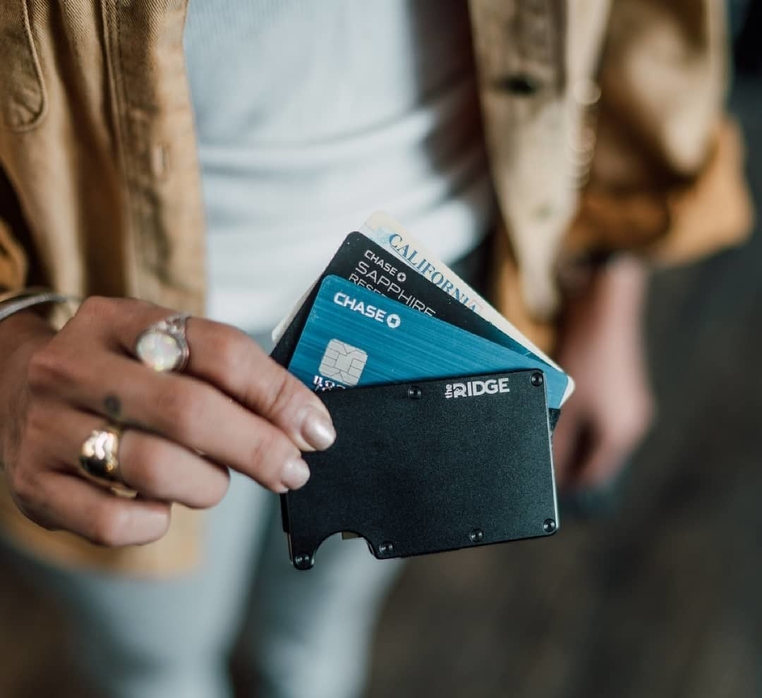Sleek wallet holding a few credit cards