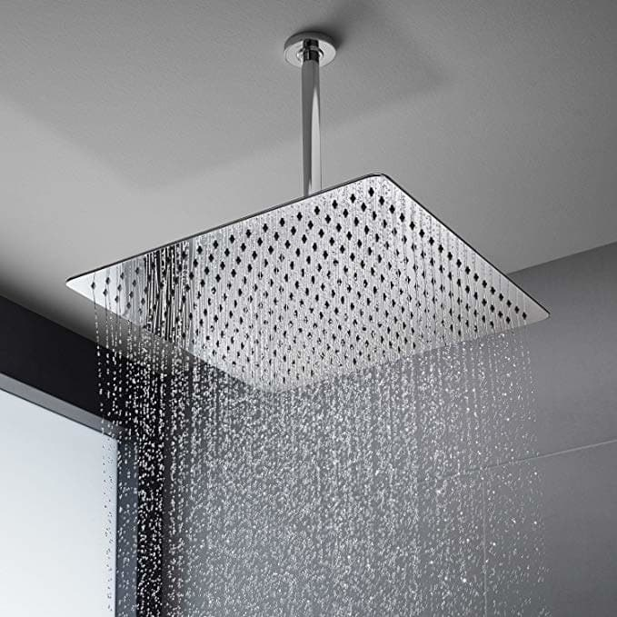 Large rectangular shower head with a rainfall-like water stream coming out