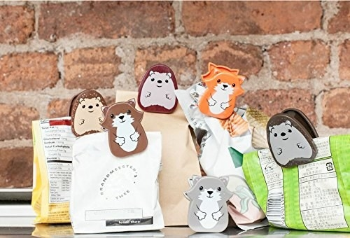 A variety of animal-shaped bag clips being used.