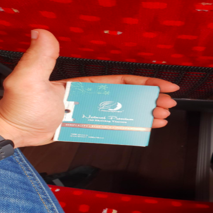 A reviewer holding the tissues compact showing it is the size of their palm