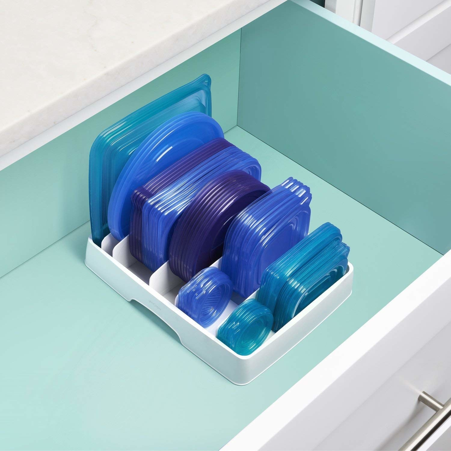 The organizer in a drawer holding six sizes of container lids
