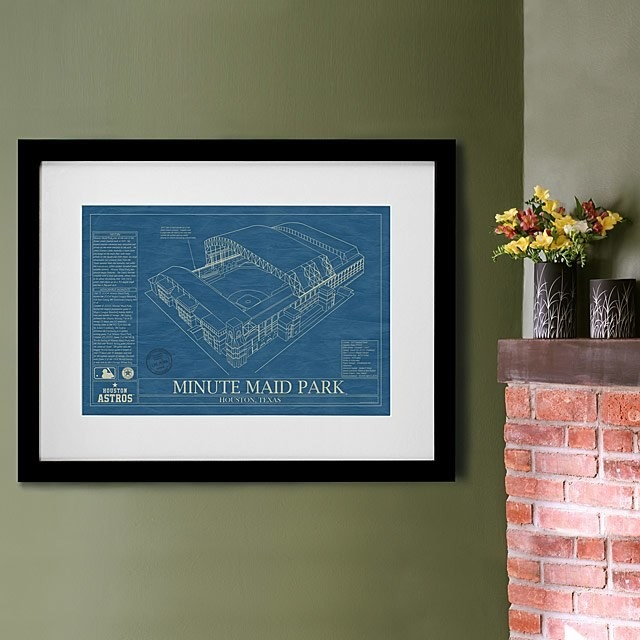 Art print of Minute Maid Park on a wall next to a fireplace mantle