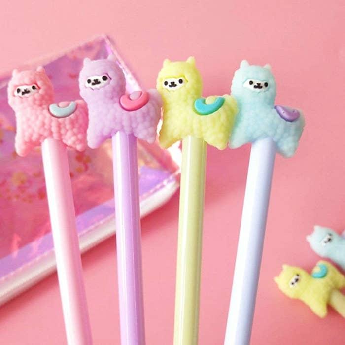 four pastel llama pens