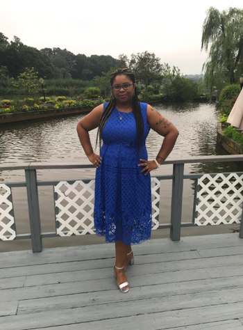Reviewer wearing the thick-strap lace dress in blue.