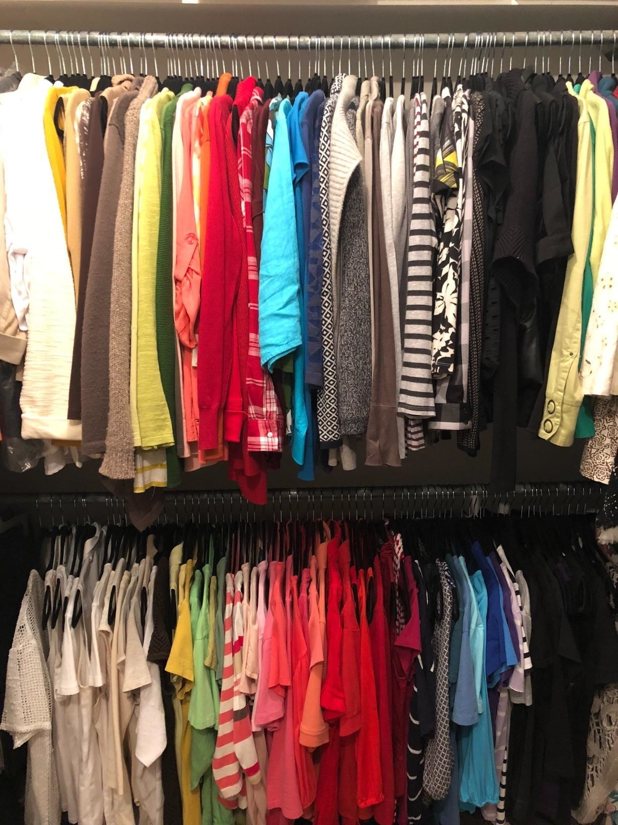 A reviewer's closet, with lots of clothes because of the slim hangers