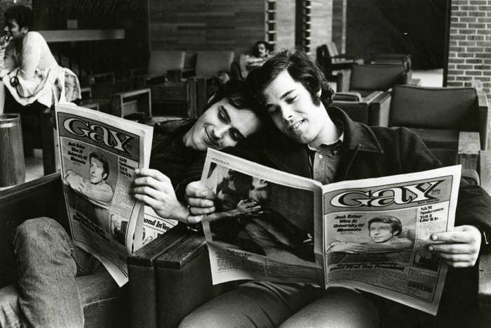 Photo by Kay Tobin Lahusen: Men reading Gay magazine, 1971.