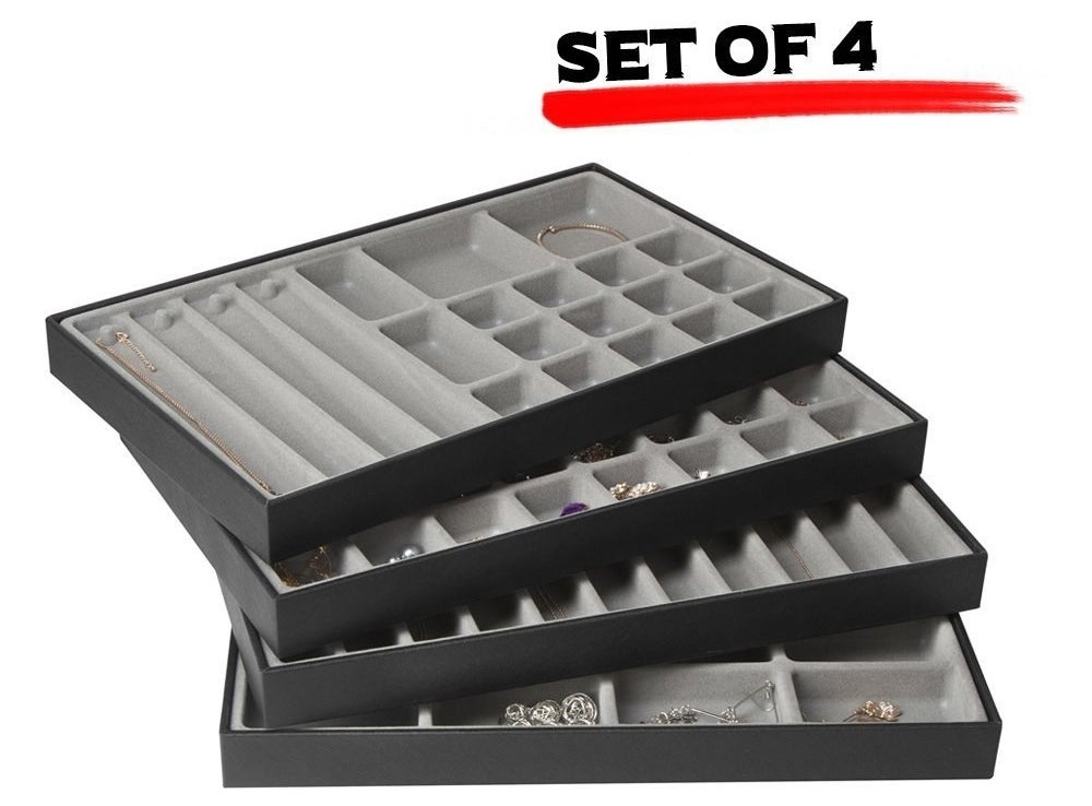 The set of four, with small and large square and long rectangular slots for different jewelry