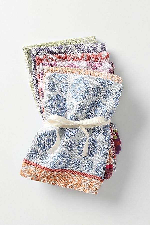bundle of printed cloth napkins with different patterns on each one