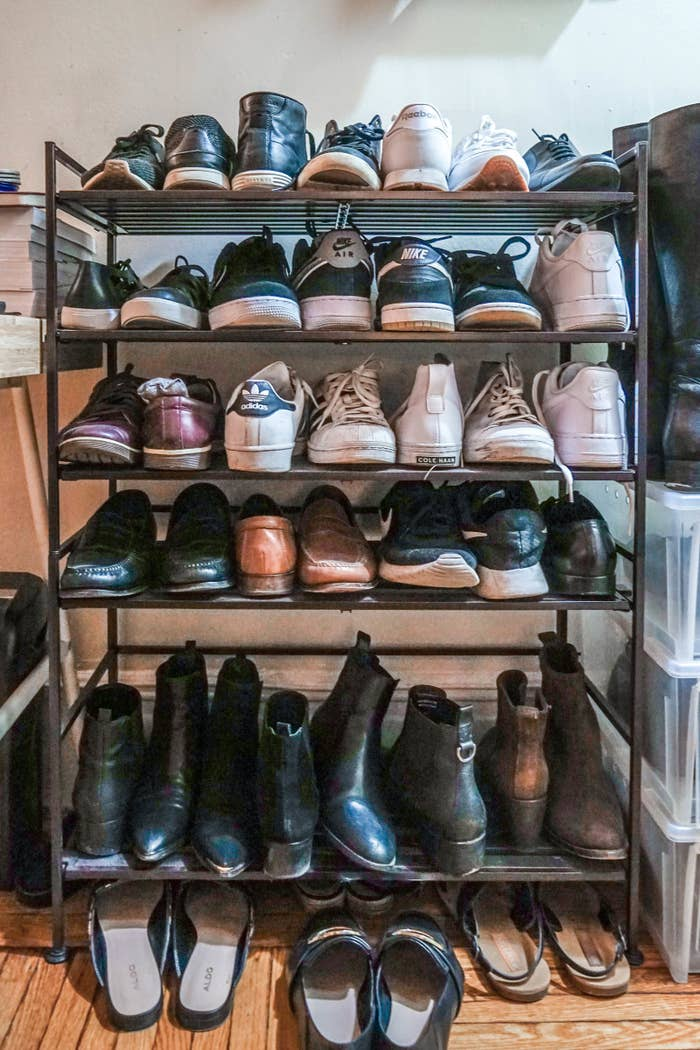 Shoe storage is always an issue when you live in a tiny apartment. Ideally, I'd like my shoes to be hidden away in a walk-in wardrobe, but sadly, that is unrealistic. With my closets already jam-packed, I needed a neat way to store my footwear in the entryway. Enter the Seville Classics 3-tier shoe rack. I bought these because they had over six thousand reviews (!!!) on Amazon and a 4.7 rating — and I'm not disappointed. First of all, it's a heavy-duty shoe rack with a good weight, not flimsy or wobbly in any way. There's a matte finish so it doesn't look cheap either. Secondly, it's customizable. I have removed one of the slats so my boots fit on the bottom. Thirdly, it's stackable. Originally, I had one of these, but as my shoe collection expanded, I needed a second one. I was able to stack one on top of the other (it's designed to do so), and it looks very neat. You could also join them horizontally, but unfortunately, I don't have enough space to test that theory out. I have pretty large shoes, and I'm able to fit three pairs (plus one single shoe, lol) on each level, and it's deep enough that my shoes don't jut out weirdly. Overall, it's a wonderful choice for the price, and I'll continue to use it until I can afford my walk-in wardrobe. —Yi YangGet it from Amazon for $29.99.