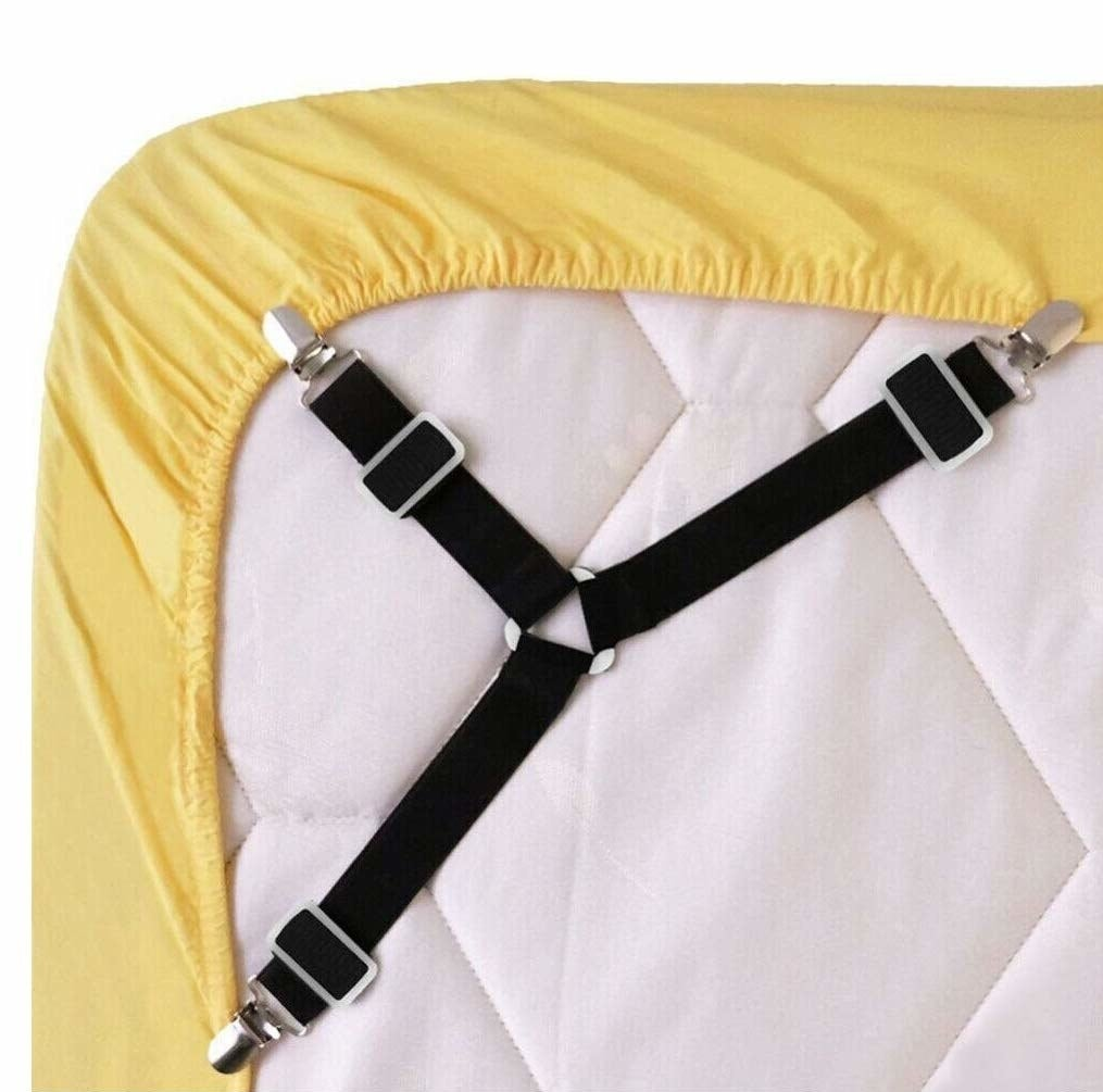 under mattress shows black suspenders attached to sheets on corners