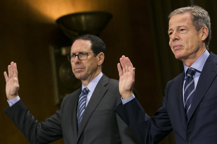 Randall Stephenson, CEO of AT&T (left), and Jeff Bewkes, CEO of Time Warner, are sworn in during a Senate hearing on their pending merger, December 2016.