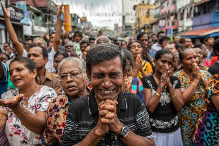 Crowds of people pray in the street near St. Anthony's Shrine in Colombo, Sri Lanka, April 28, one week after the attacks that killed nearly 300 people.