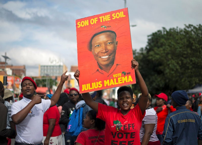 Supporters of the Economic Freedom Fighters carry a poster after leader Julius Malema.