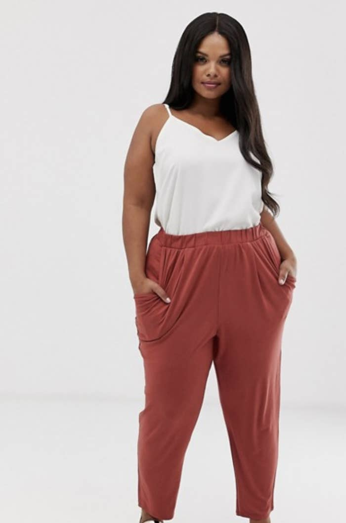 88d4bb9d0abf These dusty rose-colored jersey peg pants that look cute and classy on a  day out.