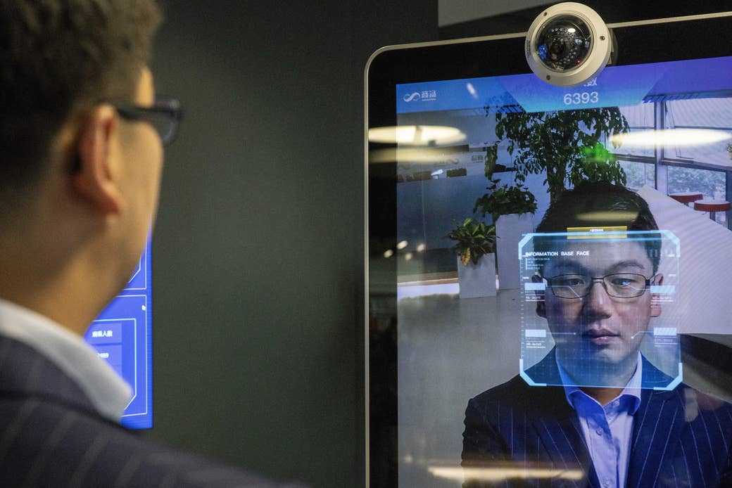 Xu Li, chief executive officer of SenseTime Group, is identified by the company's facial recognition system as he poses for a photograph at SenseTime's showroom in Beijing on June 15, 2018.
